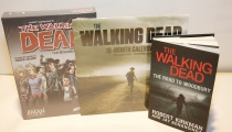 The Walking Dead prize pack including one (1) copy of the official tabletop board game, one (1) Walking Dead calendar for 2013, and one (1) copy of the second Walking Dead novel, The Road to Woodbury.
