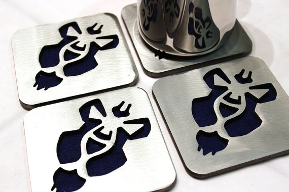 World of Warcraft Alliance insignia coasters, by Apocalypse Fabrication on Etsy.