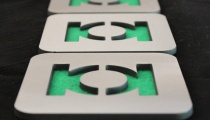Green Lantern coasters, by Apocalypse Fabrication on Etsy.