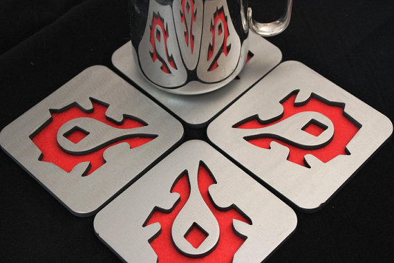 World of Warcarft Horde insignia coasters, by Apocalypse Fabrication on Etsy.