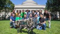Photo Credit: Jose-Luis Olivares/MIT. MIT Description: MIT Biomimetic Robotics Laboratory members pose with the MIT cheetah robot in Killian Court. (Top row, from left) Deborah Ajilo, Negin Abdolrahim Poorheravi,John Patrick Mayo,Justin Cheung, Sangbae Kim, Shinsuk Park, Kathryn L. Evans, and Matt Angle. (Bottom row, from left) Will Bosworth, Joao Luiz Almeida Souza Ramos, Sehyuk Yim, Albert Wang, Meng Yee Chuah, and Hae Won Park.