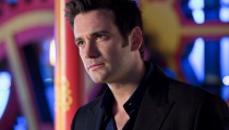 Tommy Merlin (played by Colin Donnell).  Photo Credit: The CW.