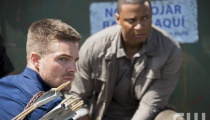 Stephen Amell as Oliver Queen and David Ramsey as John Diggle.  Photo Credit: Diyah Pera/The CW
