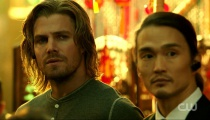 Karl Yune as Maseo Yamashiro and Stephen Amell as Oliver Queen, in a flashback to Hong Kong. Photo Credit: The CW.