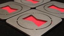 Black Widow coasters, by Apocalypse Fabrication on Etsy.