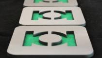 Green Lantern coasters, by Apocalypse Fabrication on Etsy.