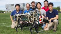 Photo Credit: Jose-Luis Olivares/MIT. MIT Description: MIT cheetah-bot experiment in Briggs Field. (From left) Sehyuk Yim, Joao Luiz Almeida Souza Ramos, Wyatt L Ubellacker, Sangbae Kim, Xu Sun, and Hae Won Park.