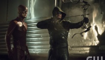 Grant Gustin as The Flash and Stephen Amell as The Arrow. Photo Credit: Cate Cameron/The CW
